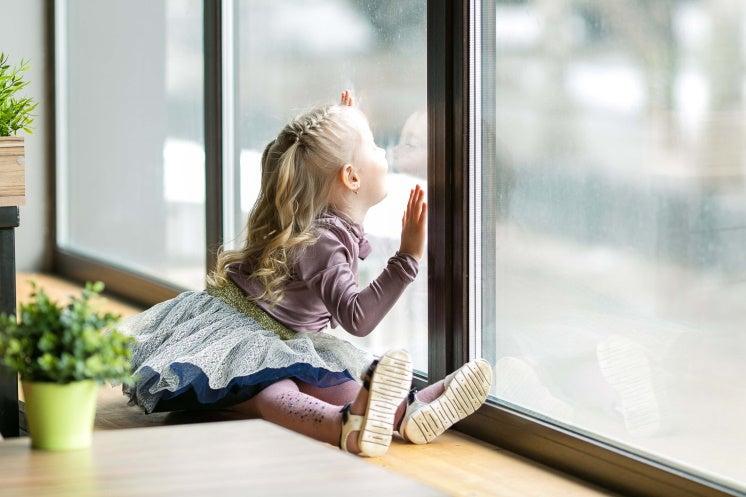 girl by a window
