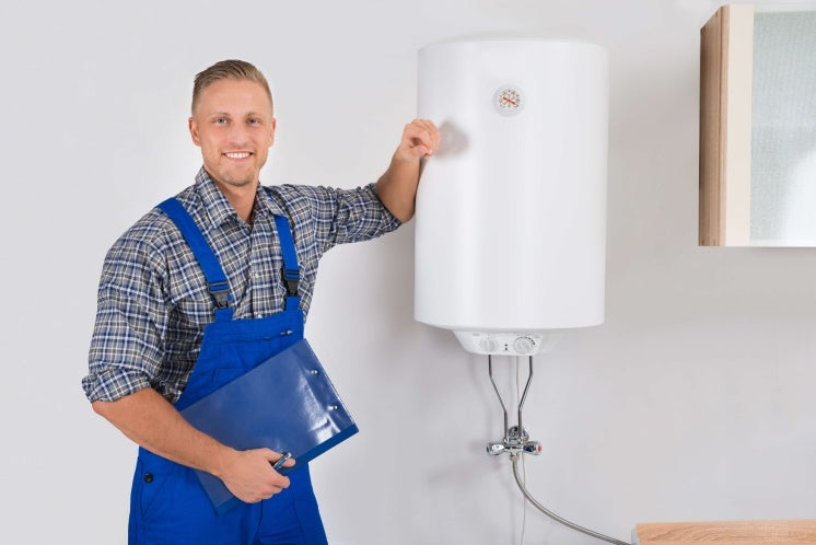 plumber standing by a new boiler