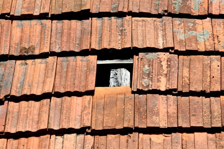 a roof with a missing tile