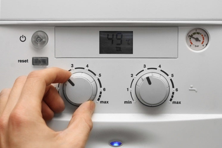 a person changes the settings on a vaillant boiler