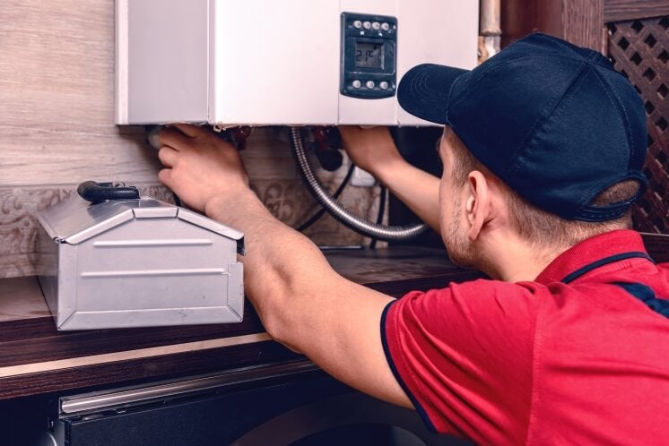 a man installs a combi boiler
