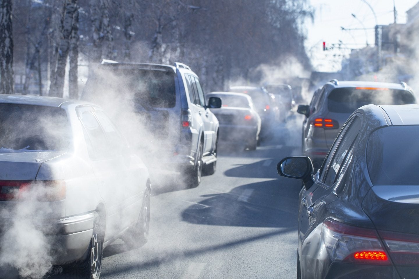 cars on road with pollution