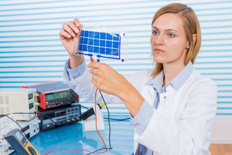 woman holding thin film solar panel