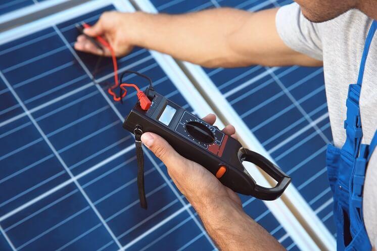 engineer taking solar panel reading