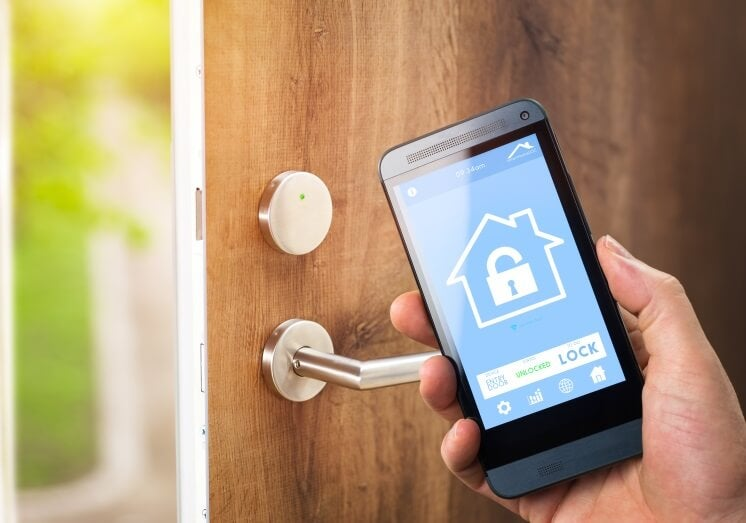 a person uses a smart lock as home security