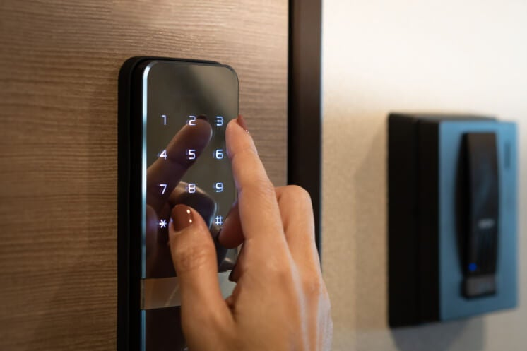 person using a home security keypad