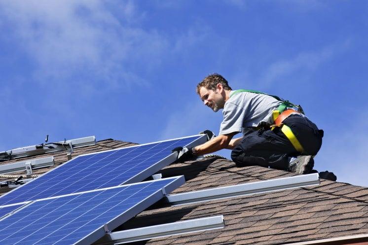specialist installing solar panels