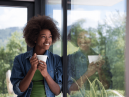 woman gazes out of windows with triple glazing