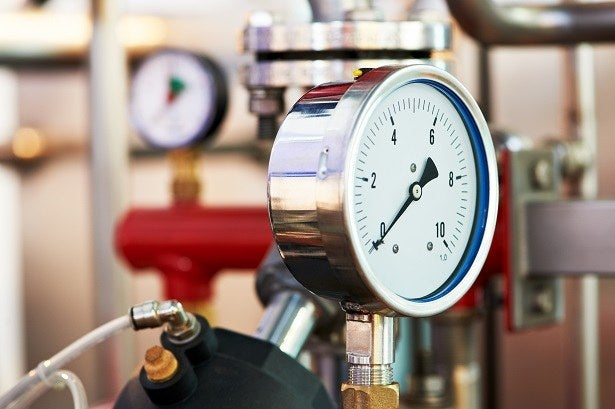 a close-up of a boiler pressure gauge
