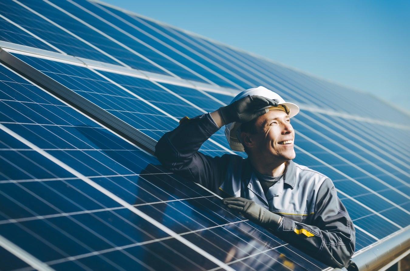 man installing solar energy