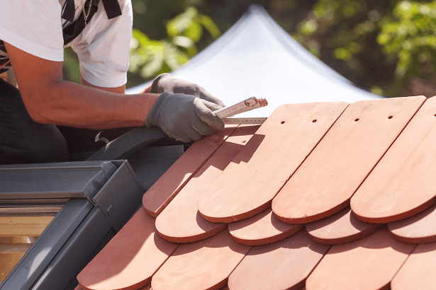 Roof tiles being fitted