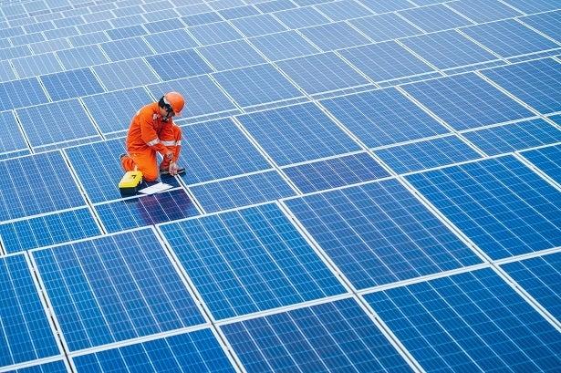 engineer on solar panel roof