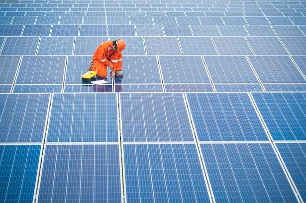 an engineer fixes solar panels