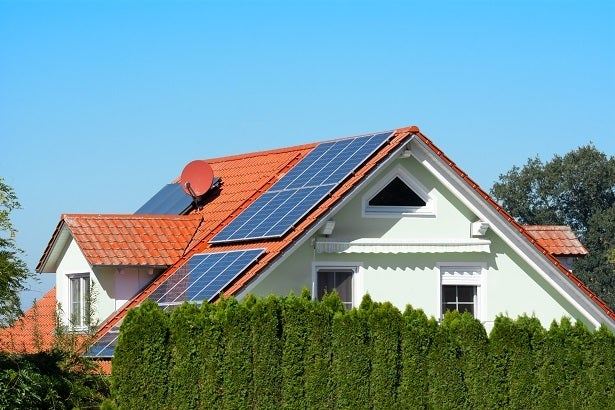 solar panels on a house with an orange roof