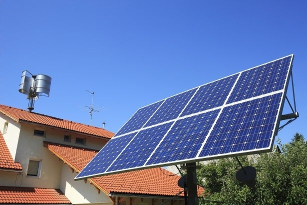 a solar panel with a solar tracker in the garden