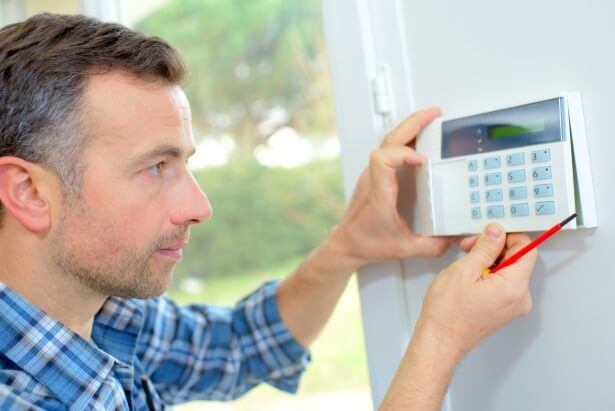 a person setting up a home security system