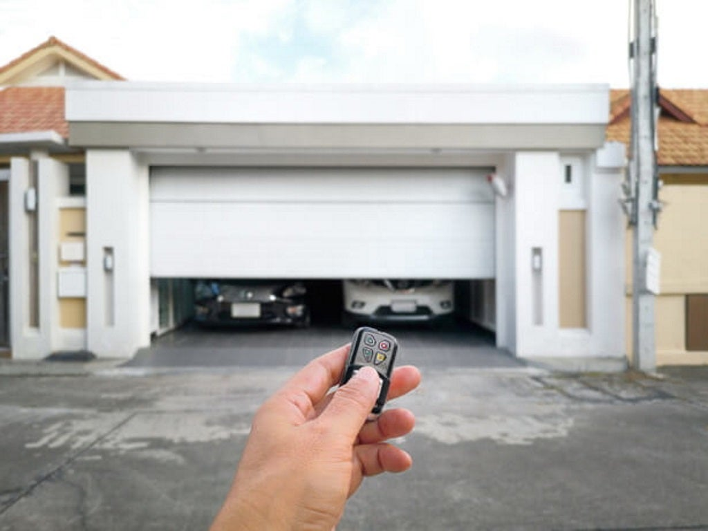 a man opens a smart garage door