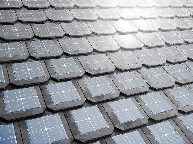 solar roof tiles on a dark roof