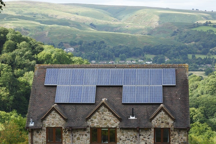 solar panels on a roof in the countryside