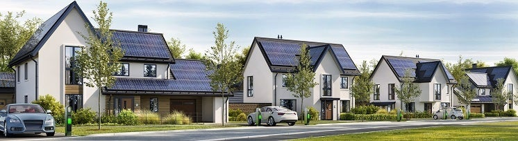 a street of houses with solar panels
