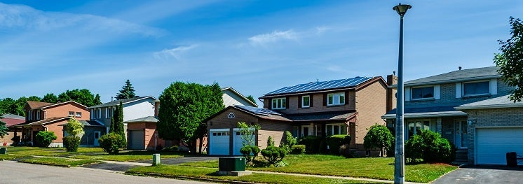 street of houses with solar panels on roof