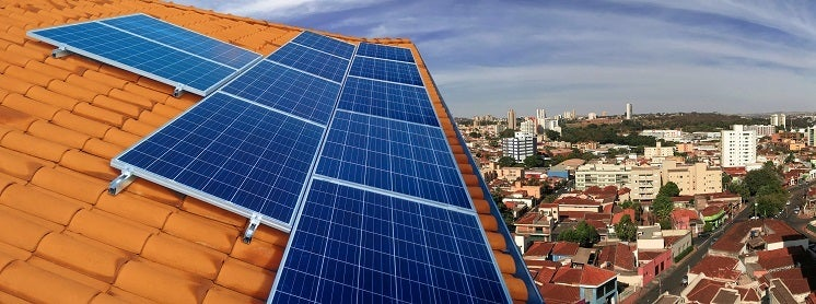 solar panels on a roof overlooking a city