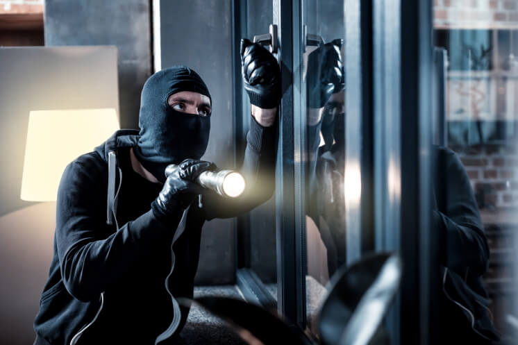 a burglar targets a vulnerable home security system