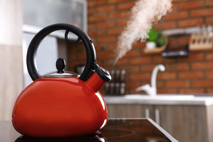 kettle whistling steam in a home