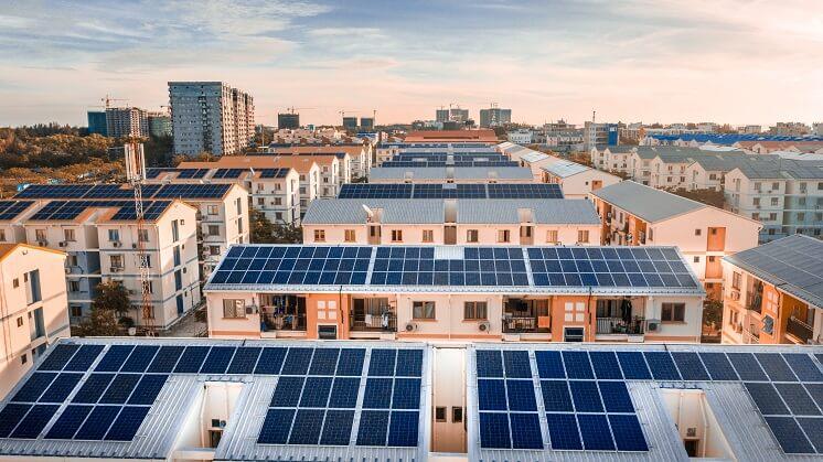 solar panels on white roofs at dusk