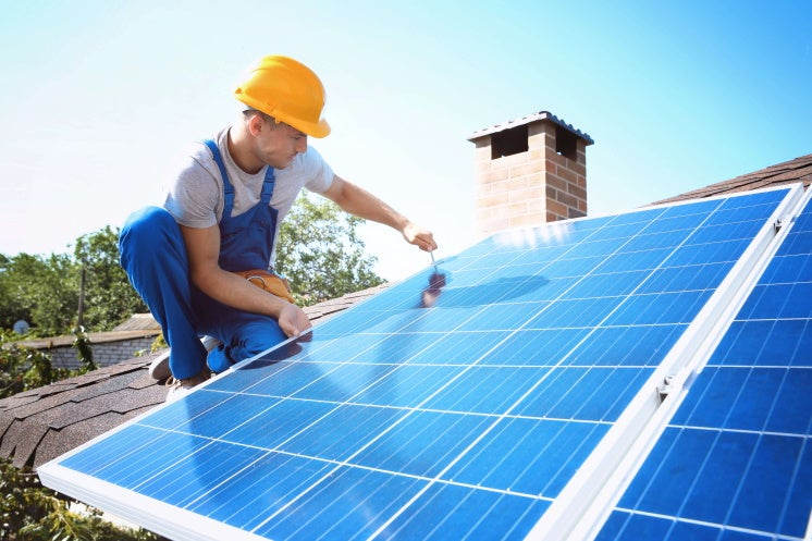 man getting a solar panel to work