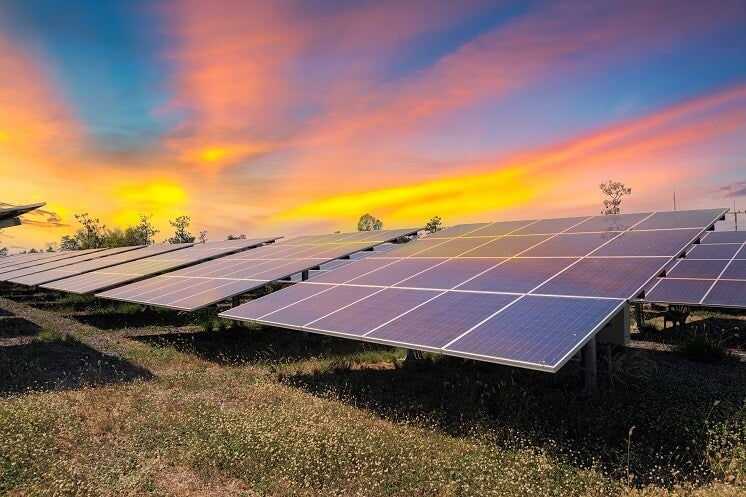 rows of solar panels in field