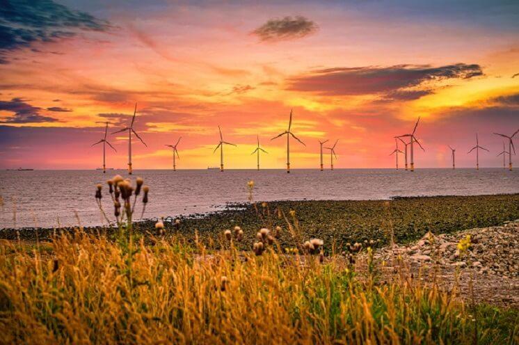 Wind turbines at sunset off the English Coast