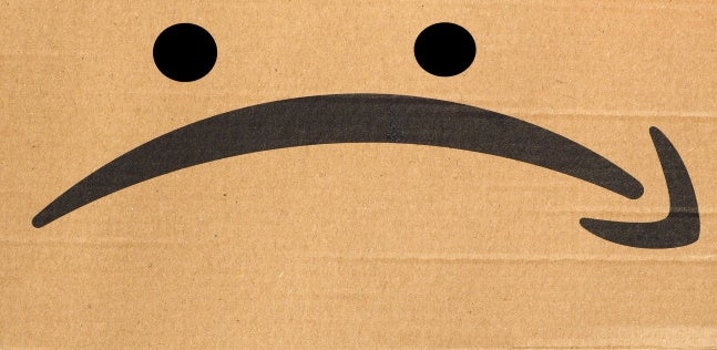 an Amazon box altered to resemble a sad face