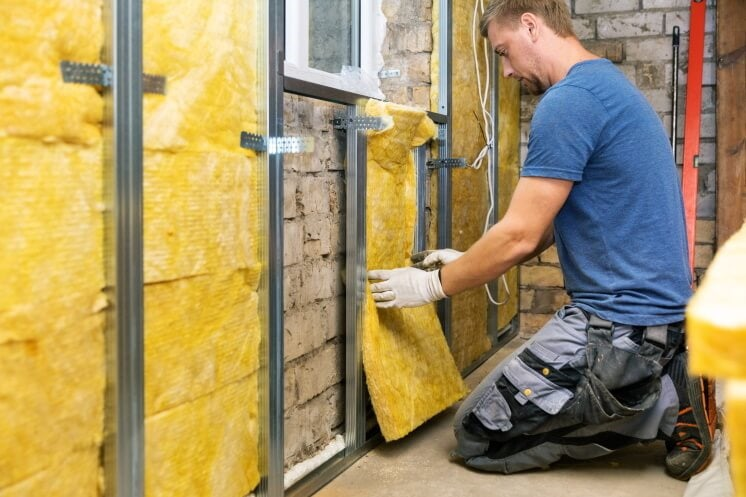 man installing solid wall insulation