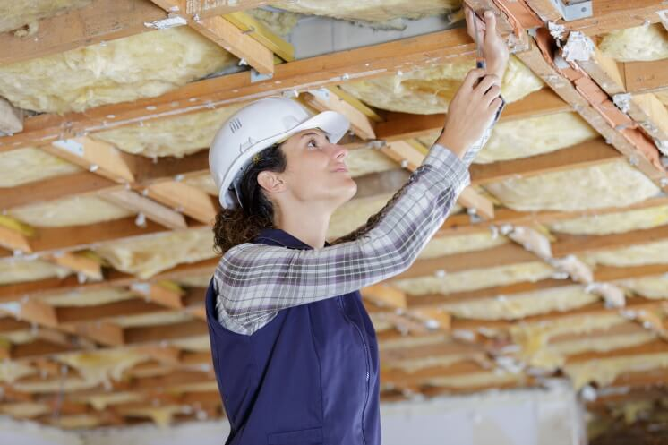 woman installs loft insulation