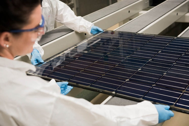 a Oxford PV perovskite-silicon solar module held by a female scientist