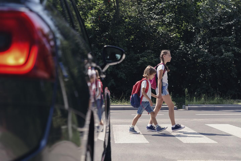 school children walking across the road