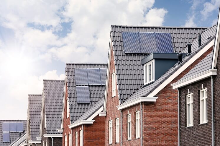 row of houses with solar panels on