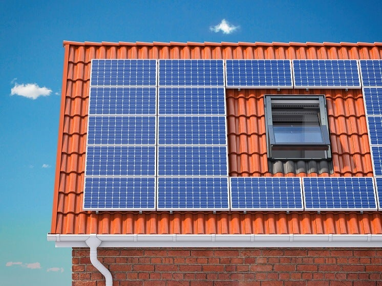 solar panels on a red tiled roof