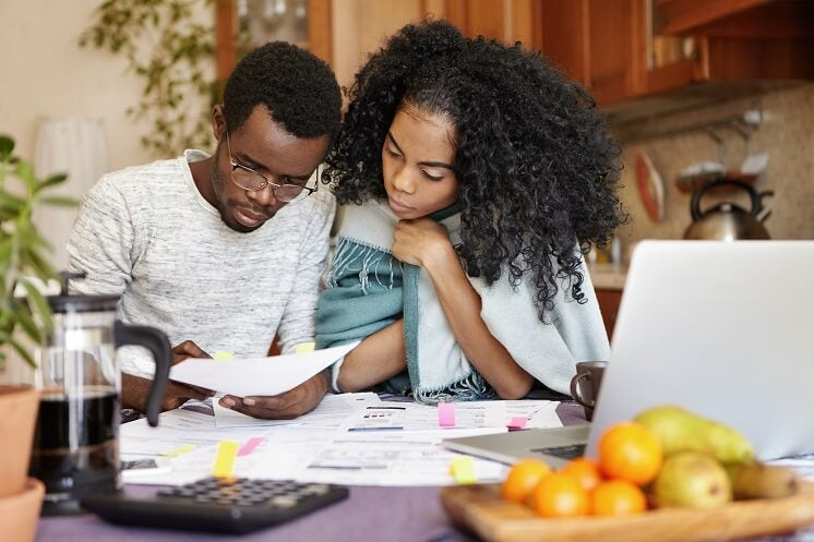 a couple looking at energy bills