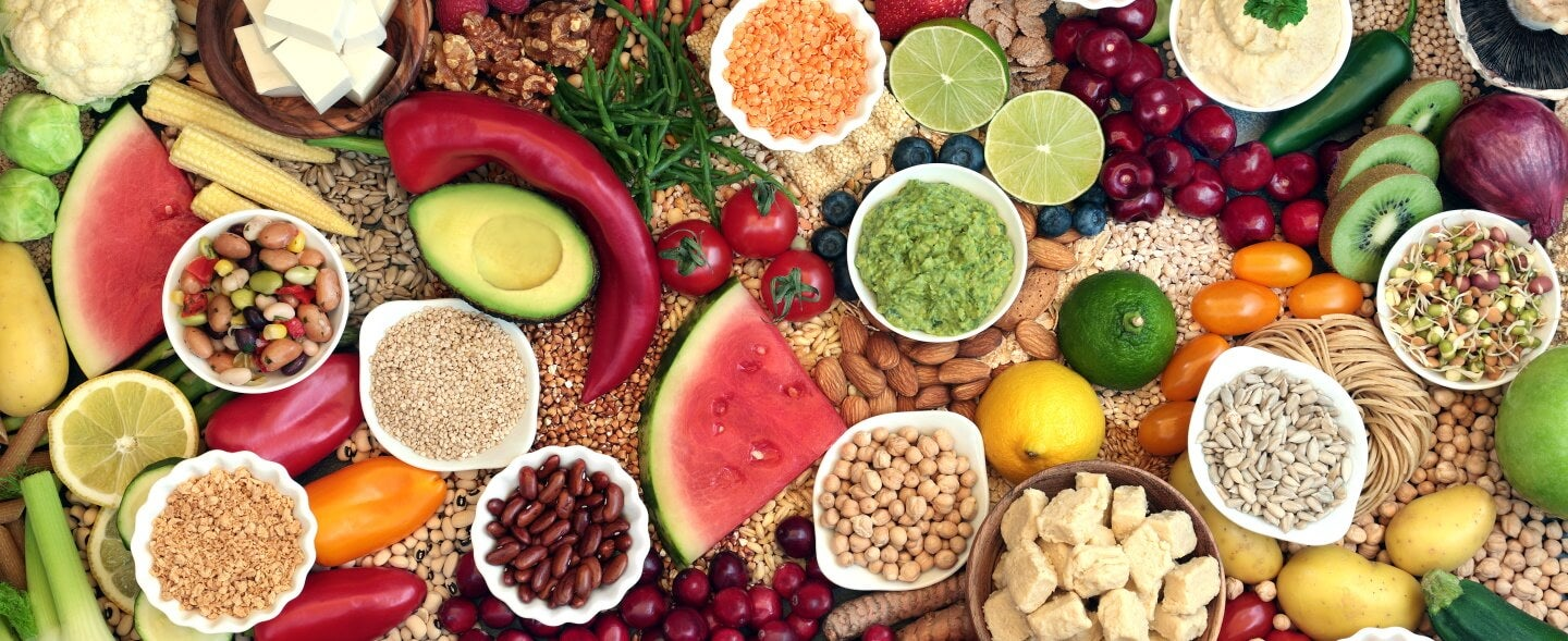 vegan foods including nuts, fruits, and vegetables