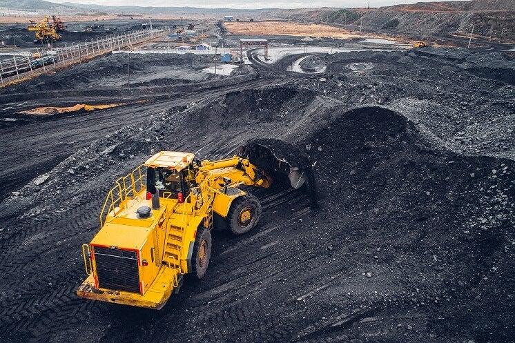 a digger collecting coal