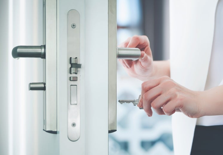 woman locking a door