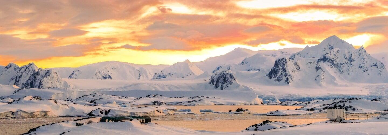 Ice-covered ridges at twilight at the base of Antarctic Peninsula
