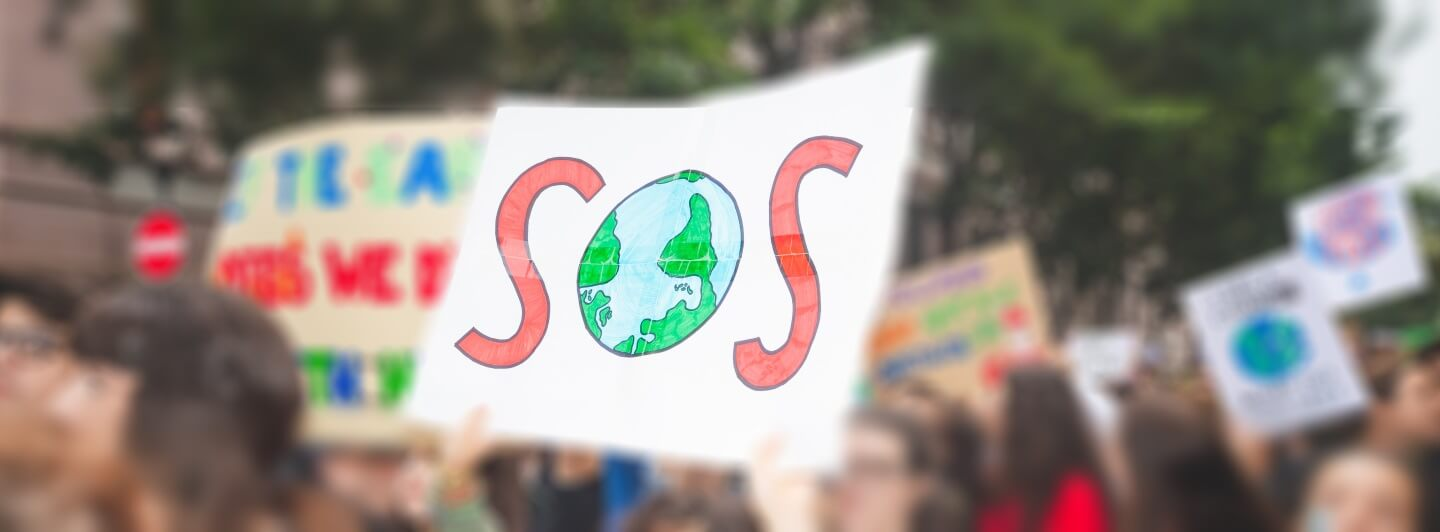 climate protest with SOS sign