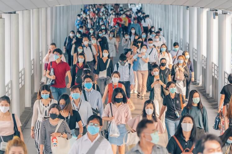 Crowd of people with face masks on