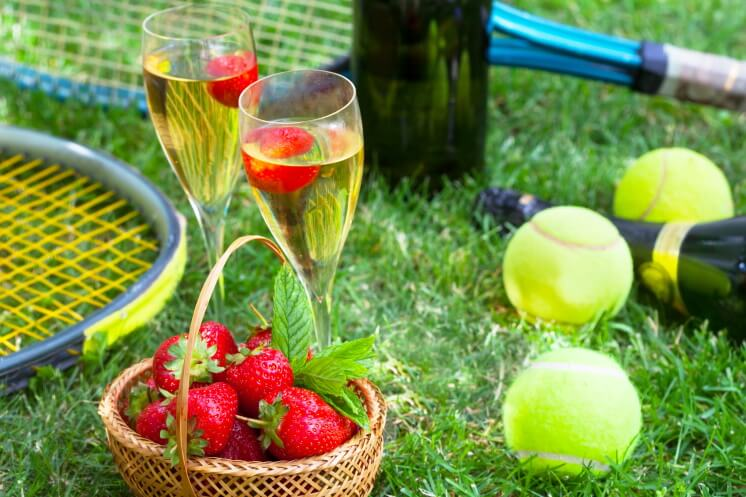 wimbledon tennis balls, strawberries and champagne