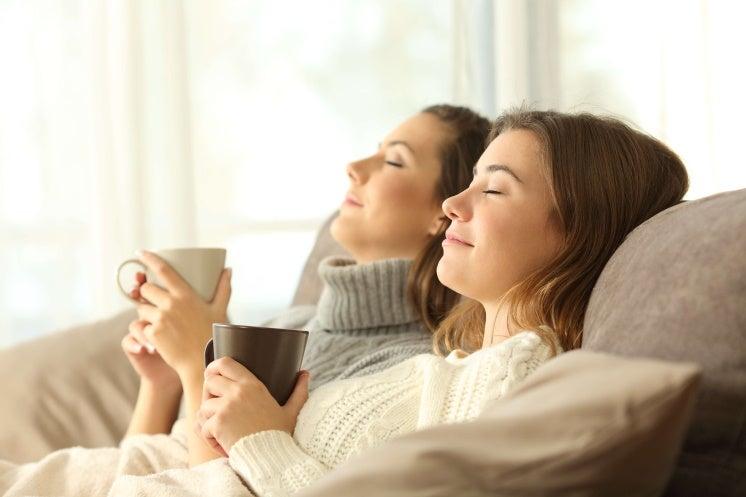 women appreciating a heated home
