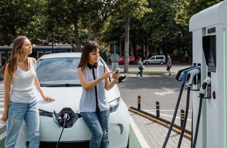 women with an electric car