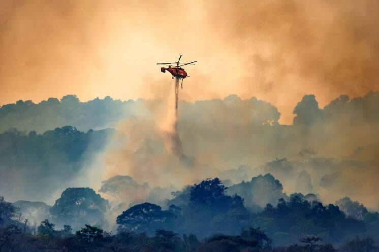 Helicopter putting fire out